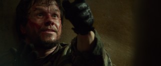 Critically wounded Marcus Luttrell (Mark Wahlberg) is given shelter by some sympathetic Afghan villagers.