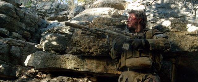 Marcus Luttrell (Mark Wahlberg) clings to life and his rifle, alone in the mountains of Afghanistan.