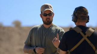 "The real Marcus Luttrell advises Ben Foster on how to hold his weapon in ""Will of the Warrior."""