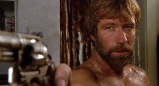 J.J. McQuade (Chuck Norris) does not take kindly to unannounced guests, shirtlessly greeting them with a revolver in their face.