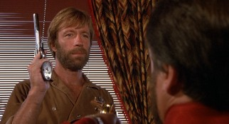 It will take much more than a gun-toting dwarf crime boss in a wheelchair (Daniel Frishman) to rattle Lone Wolf McQuade (Chuck Norris).