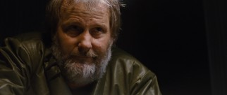 A bearded Jeff Daniels plays Abe, the man sent from the future to oversee and enforce the loopers.