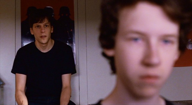 "Jonah (Jesse Eisenberg) listens to his younger brother Conrad (Devin Druid) share his personal writing in ""Louder Than Bombs."""