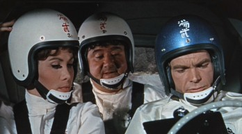 Carole (Michele Lee), Tennessee (Buddy Hackett), and Jim (Dean Jones) look over Herbie's instructions.
