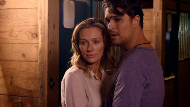 "Kennedy Blaine (Michaela McManus) and Derek Sterling (Diogo Morgado) share a tender moment in the horse stables in ""Love Finds You in Valentine."""