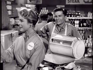"Bud Anderson (Billy Gray) has his sights set on Marion the checkout girl (Gail Land) in the ""Father Knows Best"" episode ""Young Love."""