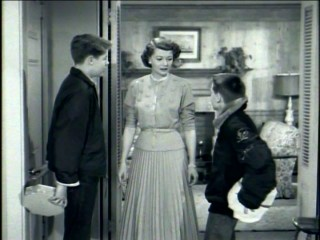 "David and Ricky Nelson do a terrible job of hiding their Valentine's Day gifts for their mother Harriet in ""Ozzie and Harriet."""