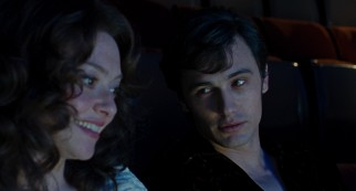 "A young Hugh Hefner (James Franco) invites Linda Lovelace (Amanda Seyfried) to sit beside him during the private ""Deep Throat"" screening he hosts."
