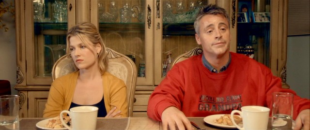 Charlie (Matt LeBlanc) sweats through a date with Molly (Ali Larter) in a World's Best Grandpa sweatshirt.