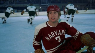 Hockey jock Oliver (Ryan O'Neal) fails to keep his head in the game, as he checks the stands after a fall on the ice.