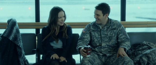 "In ""Love the Coopers"", Eleanor (Olivia Wilde) meets Joe (Jake Lacy), a soldier on leave for the holidays who agrees to pose as her boyfriend."