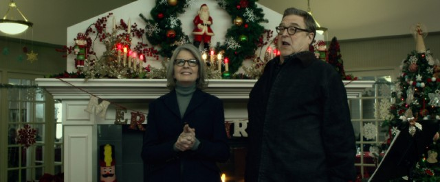 Separation-bound Charlotte (Diane Keaton) and Sam Cooper (John Goodman) sing Christmas carols at a nursing home, but disagree on some of the lyrics.