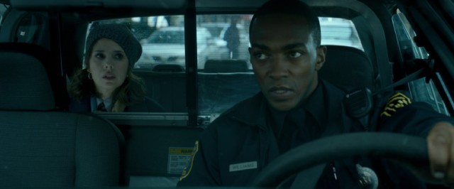 The world's slowest arrest becomes a therapy session, as Emma (Marisa Tomei) plays backseat doctor to the robotic Officer Williams (Anthony Mackie).