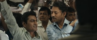 Saajan's replacement Shaikh (Nawazuddin Siddiqui) drops some knowledge on him during a typically cramped train ride.