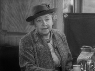 Dame May Whitty plays Miss Froy, the titular vanishing lady whose existence is called into question.