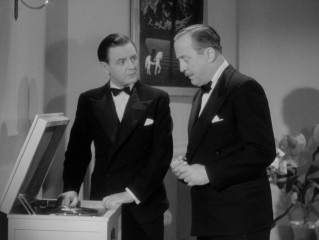 "In ""Crook's Tour"", Caldicott (Naunton Wayne) and Charters (Basil Radford) try to make sense of a German announcement within the record that endangers them."