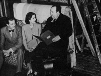 Alfred Hitchcock directs actors Michael Redgrave and Margaret Lockwood in this still set to Truffaut's interview of the director.