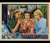 Iris and her friends (Googie Withers and Sally Stewart) enjoy cocktails in this colorized lobby card from the stills gallery.