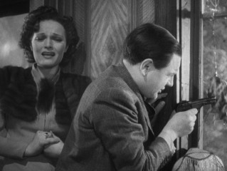"""The Lady Vanishes"" concludes with a shootout that instills fear in ""Mrs."" Todhunter (Linden Travers) and confidence in Caldicott (Naunton Wayne)."