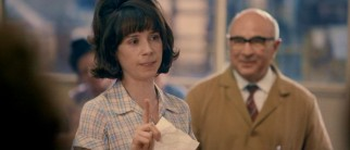 Rita O'Grady (Sally Hawkins) takes offense at the Ford Motor Company's response to the single-day machinist work stoppage, to the out-of-focus delight of union organizer Albert (Bob Hoskins).