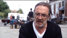 Director Nigel Cole's hair blows in the wind during his making-of featurette interview.
