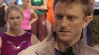 Payson (Ayla Kell) tries to convince Sasha (Neil Jackson) to stay as their coach after he's been disillusioned by their parents.