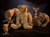 "The original Pooh dolls, as seen in making-of featurette ""The Story Behind the Masterpiece."""