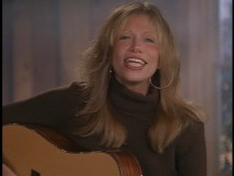 "I would have preferred Kenny Loggins and Amy Grant's classic ""Return to Pooh Corner"", but Carly Simon does a pretty good job with the theme to ""Winnie to Pooh."""