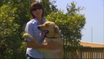 "Dog trainer Mathilde de Cagny is embraced by her pupil Clyde in ""Finding Marley."""