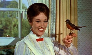 Magical English nanny Mary Poppins (Julie Andrews) harmonizes with a visiting bird thanks to the wonder of Disney Audio-Animatronics.