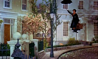 Mary Poppins makes an iconic first appearance on Cherry Tree Lane by flying in on her umbrella.