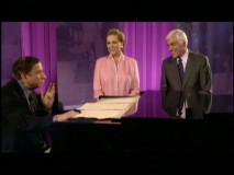 "Richard Sherman, Julie Andrews, and Dick Van Dyke share a laugh around a piano in ""A Magical Musical Reunion."""