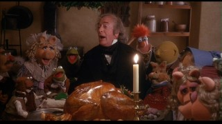 Turkey and a song: Scrooge drops in on the Cratchits' Christmas dinner with the biggest bird in town.