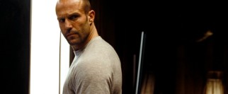 That's so Statham! Arthur (Jason Statham) shoots one of his balding British portrayer's signature over-the-shoulder looks to indicate he's watching his back.