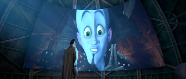 Via hijacked video screen, Megamind explains to Metro Man how things will go down differently in his latest diabolical plan.