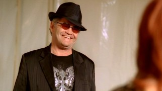 Micky Dolenz turns up as a fundraiser-performing version of himself for some Monkees jokes.