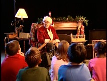 "Dressed as Santa Claus, Wayne Allwine leads five kids in a sound-enhanced reading of ""A Visit from St. Nicholas."""