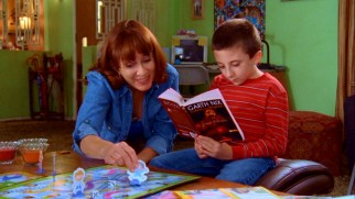 Frankie (Patricia Heaton) gives bookworm son Brick (Atticus Shaffer) a socialization hand by playing his turn for him in a playdate Chutes & Ladders game.