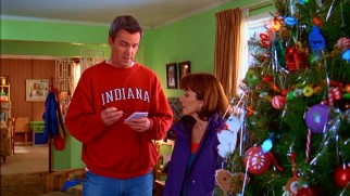 With the tree up and decorated, a calm Mike checks one more item off his Christmas task list, to Frankie's irking.