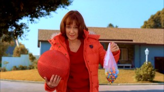 Frankie (Patricia Heaton) tries to motivate Brick athletically with a kicks for candy program.