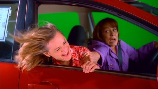 Guest starring as a motivational consultant who's only posing as a drunk potential customer, Amy Sedaris has her refreshing head out the car window green screen drive preserved as a deleted scene.