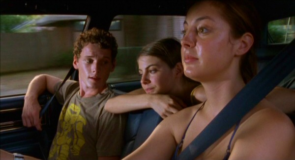 Two out of three teenagers (Anton Yelchin, Willa Holland, Eva Amurri) are visibly sweaty whilst taking this summer drive in the middle of nowhere (Louisiana).