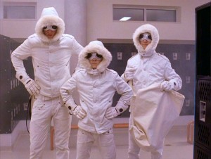 The Minutemen, or Snowsuit Guys as they're more commonly known, don their white outfits in the school locker room, where they intend to help their fellow outcast.
