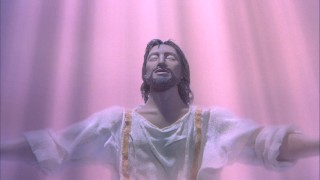 Just baptized by John, Jesus Christ basks in the pink light of the Holy Spirit.