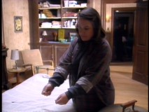"Kathy Bates acts against an empty bed in production footage from ""Misery Loves Company."""