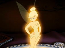 Tinker Bell sizes herself up atop a handheld mirror.