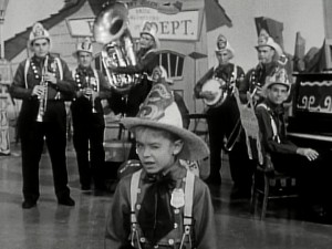 "Mouseketeer Cubby winks as animator Ward Kimball's Dixieland band the Firehouse 5 + 2 show up for ""Anything Can Happen Day."""