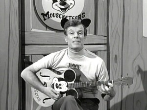 Head Mouseketeer Jimmie Dodd equipped with his two most turned-to tools: his Mouse-ketar and abundant charisma.