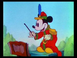 "Mickey prepares to strike up the band in his first color short, ""The Band Concert."""