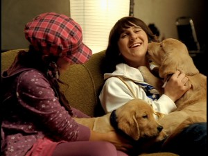 "Mitchel Musso enjoys the company of dogs in his ""Lean on Me"" music video from the ""Snow Buddies"" DVD."